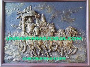 Relief motif orang dan kuda