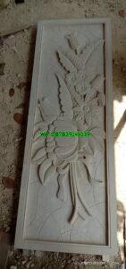 Relief batu alam motif bunga