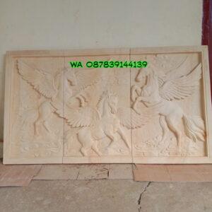 Relief kuda terbang batu alam